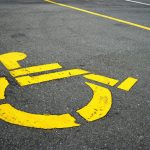 handicapped icon painted in parking spot