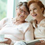 Young nurse spending time with happy elder patient