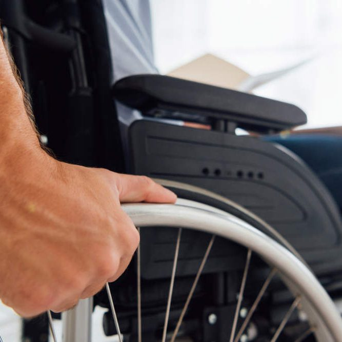 close up of man sitting in wheelchair