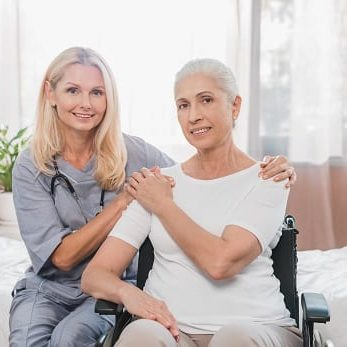 woman in wheelchair sitting beside nurse